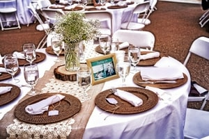Table settings for the reception with chic chargers.