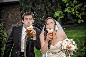 Why take things seriously when you can blow beer foam at your wedding?