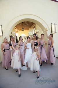 Informal pose of bride, bridesmaids, and flower girls; David Girard Vineyard, Placerville, CA