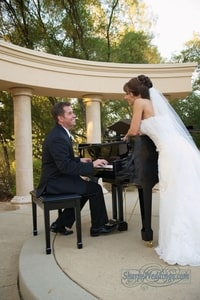 Bride listening to groom play the piano; David Girard Vineyard, Placerville, CA