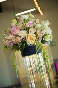 Closeup detail of cylindrical wedding dinner centerpiece floral arrangement