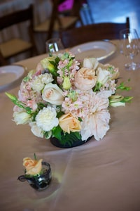 Closeup detail of basic wedding dinner centerpiece floral arrangement
