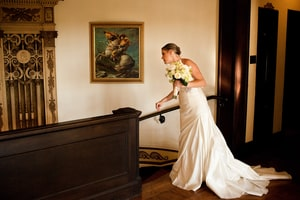 Bride with bridal bouquet; Grand Island Mansion, Walnut Grove, CA