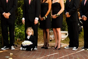 A tired ring bearer at this traditional outdoor wedding; Grand Island Mansion, Walnut Grove, CA