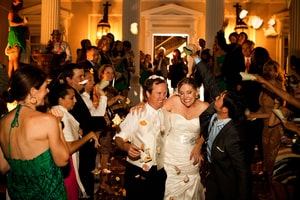 Bride and groom greeted by friends and family at wedding reception; Grand Island Mansion, Walnut Grove, CA