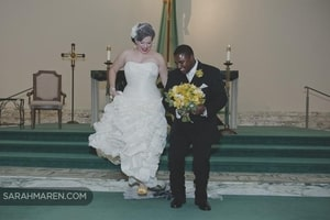 Bride and groom jump the broom to complete their wedding ceremony