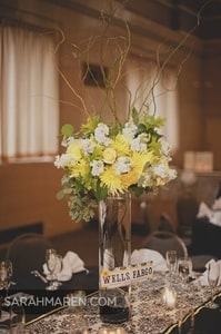 Tall, cylindrical vase for centerpiece floral arrangement at the wedding reception dinner