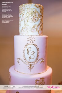 3-tier wedding cake with pink icing and delicate gold decoration