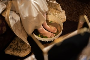Bride soaking her feet in preparation for wedding ceremony