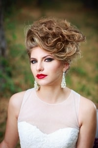 Closeup of bride's hair, makeup, and jewelry
