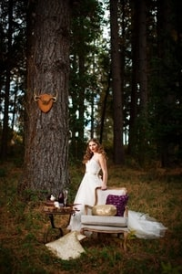 This bride brought a chair and table to the forest
