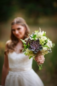 Closeup of bridal bouquet containing flowers suited to a forest environment
