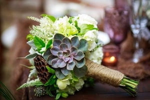Closeup of bridal bouquet with succulent pods featured in the forest theme