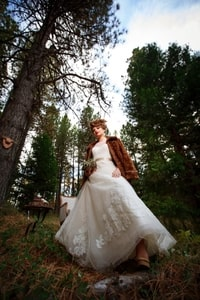 Forests can be cold and hard on the feet so this bride is wearing a fur coat and boots