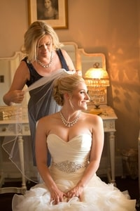 Getting the bride dressed for the wedding