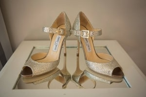 Closeup of bride's gold shoes