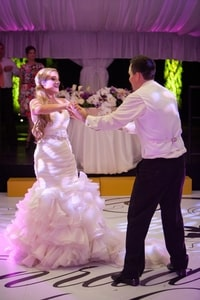 Bride and groom in their first dance after the wedding
