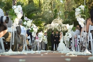 Taking vows during wedding ceremony; Grand Island Mansion, Walnut Grove, CA
