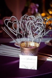 Purple, heart-shaped sparklers for the wedding celebration