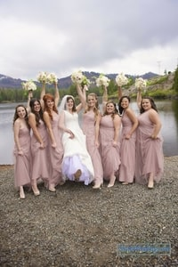 Bridesmaids showing off their blush pink dresses with the bride in traditional white; Lake Mary, Sugar Bowl Ski Resort, Norden, CA