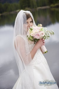 Bride holding bridal bouquet with blush pink roses; Lake Mary, Sugar Bowl Ski Resort, Norden, CA