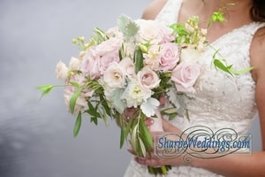 Closeup of bridal bouquet with blush pink roses
