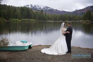 Bride and groom in formal pose on beach; Lake Mary, Sugar Bowl Ski Resort, Norden, CA