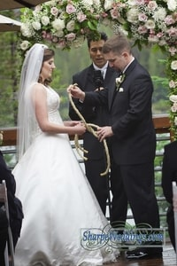 Literally tying the knot as part of wedding ceremony; Lake Mary, Sugar Bowl Ski Resort, Norden, CA