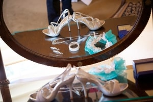 Bride's accessories - shoes, jewelry, and blue garter