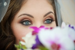 Closeup of bride's blue eyes, the inspiration for this wedding's colors