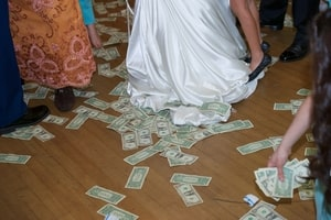 Dancing on the money floor at the wedding reception