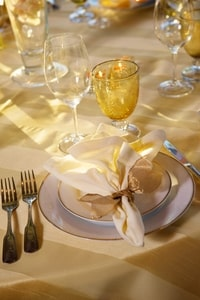 Yellow and gold place setting for wedding dinner
