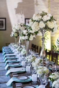 Dinner table centerpieces at Urban Chic wedding in Sacramento, CA