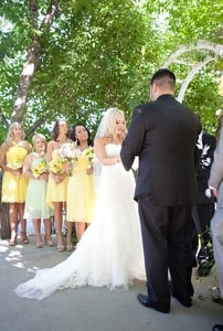 Wedding couple taking vows; Brookshire Gardens, El Dorado, CA