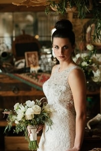 Bride in lace gown with bouquet