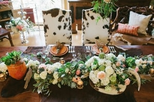 Wedding couple table - chairs have rustic, cowhide flair