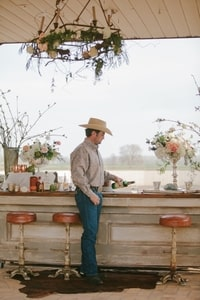 Groom - a cowboy - at bar; Murieta Inn and Spa, Rancho Murieta, CA