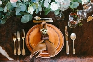 Wedding reception place setting: dinner plates and flatware