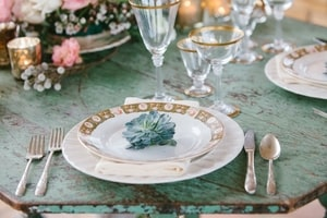 Wedding reception place setting: succulent accents on turquoise wood table rustic glamour